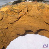 View of the pipe bore exhibiting heavy red Iron Oxide corrosion product