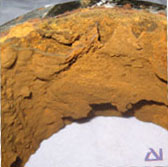 View of the pipe bore exhibiting pustules of red Iron Oxide corrosion product